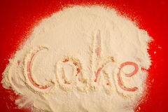 Close up of word cake written in flour Stock Photo