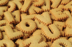 Close-up of the word I LOVE U spelled with alphabet shaped biscuits on pile of the same biscuits Stock Photos