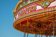 Close up of the word pleasure on a vintage merry go round. Close up of the word pleasure on a merry go round Stock Photography