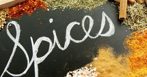 Word spices written on slate with various spices 4k. Close-up of word spices written on slate with various spices 4k stock footage