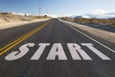 Close up of word start on suburban asphalt road stock photography