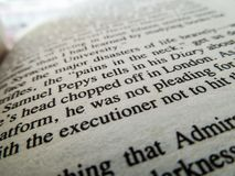 Close up of words on  a book with the words `executioner` in focus royalty free stock photo