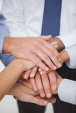 Close up on work teams hands all together. In bright office Royalty Free Stock Photo