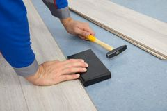 Close-up of a worker assembling laminate floor Royalty Free Stock Photography