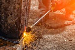 Builder weld metal pipe royalty free stock image