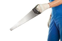 Close-up of worker cutting with saw Stock Image