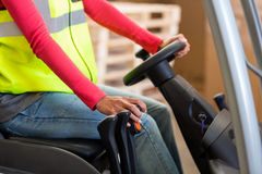 Close up of worker is driving a pallet truck Royalty Free Stock Photo
