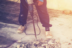 Close up worker man mason drilling cement concrete floor with ma Royalty Free Stock Photography