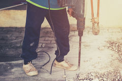 Close up worker man mason drilling cement concrete floor with ma Royalty Free Stock Photo