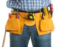 Close-up on worker's toolbelt Stock Images