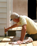 Close up Worker Staining Deck Stock Image