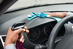 Close-up Of A Worker Wiping Dashboard Royalty Free Stock Photography