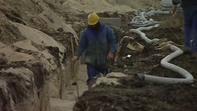 Close up of workers in cable ditch stock footage