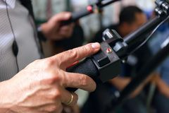 Close-up of working camera of man hand, operator at work. Stock photo Stock Image