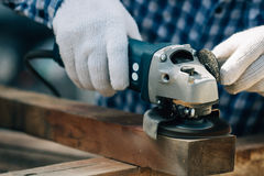 Close up working carpenter shaving wood Royalty Free Stock Images