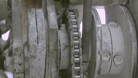 Working rotating mechanism with chain transmission. Close up working metal rotating gear with chain gear stock video footage