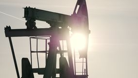 Close-up of working oil pump in a bright sunny day stock footage