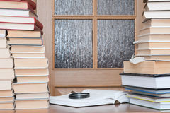Close-up of working place. With books loupe and door with glass royalty free stock image