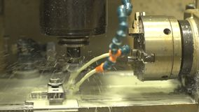Turning lathe in operation. Close-up of working process of lathe and moulding machine with numerical control. Tech process of metalwork and machine manufacturing stock video footage