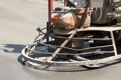 Close up of an working ride on power trowel machine on a concrete slab Stock Photos