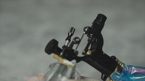Close up of working tattoo machine stock video footage