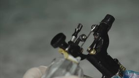 Close up of working tattoo machine. Slow motion HD stock video