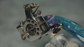 Close up of working tattoo machine. Slow motion HD stock footage