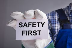 Workman Showing Safety First Sign royalty free stock photo