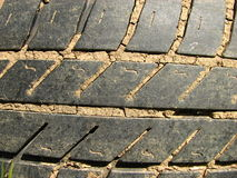 Close-up of worn and muddy tire Royalty Free Stock Photography