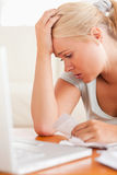 Close up of a Worried blond woman accounting Stock Images