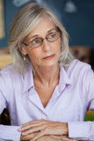 Close up of worried senior woman looking away Stock Photography