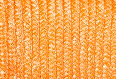 Orange wicker background. Close up on woven rattan pattern. Wicker background royalty free stock photography