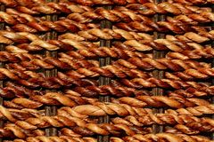 A close up of woven rattan texture; beige and brown natural colours, background image. stock photo