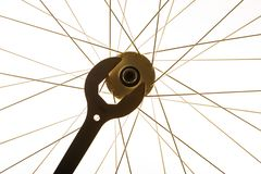 Wrench and bicycle spokes of bike wheel. Close-up of wrench and bicycle spokes of bike wheel stock images