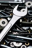 A close-up of a wrench with metal fasteners Stock Photos