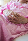 Close up wrinkled hands Stock Photo