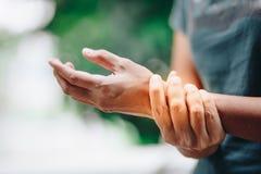 Close up Wrist pain. Woman royalty free stock photo