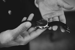 Man holding a watch in the hands Royalty Free Stock Images