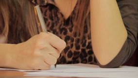Close-up writing down information, signing papers, agreement. Stock footage stock video
