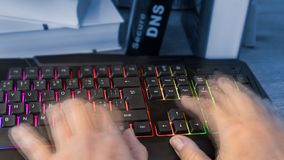 Colored computer keyboard with human hands in motion royalty free stock photo