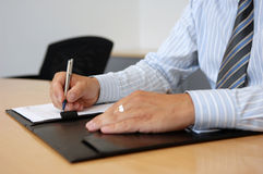 Close-Up Of Writing Hands Stock Image