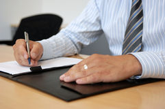 Close-Up Of Writing Hands Stock Photography