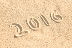 Close up on 2016 written in the sand Stock Image