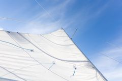 Close up of yacht sail on sky background. Close up of yacht mast and sail on sky background. Sailing boat part royalty free stock images