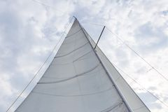 Close up of yacht sail on sky background. Close up of yacht mast and sail on sky background. Sailing boat part royalty free stock photo