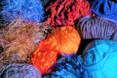 Balls and skeins of yarn. Close up of yarn textures and colors clustered together. Varied colors, some new and rolled balls, others the remnants from past royalty free stock photos