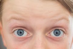 Close up of an 8 year old`s blue eyes stock images