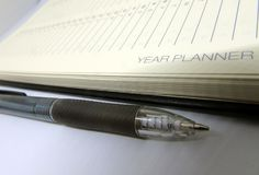 Year Planner Diary Page with Black Pen Royalty Free Stock Photography