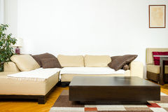 Close-up of yellow angular with pillows and low table in exclusi Stock Images