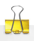 Close up of a yellow binder clip Stock Images